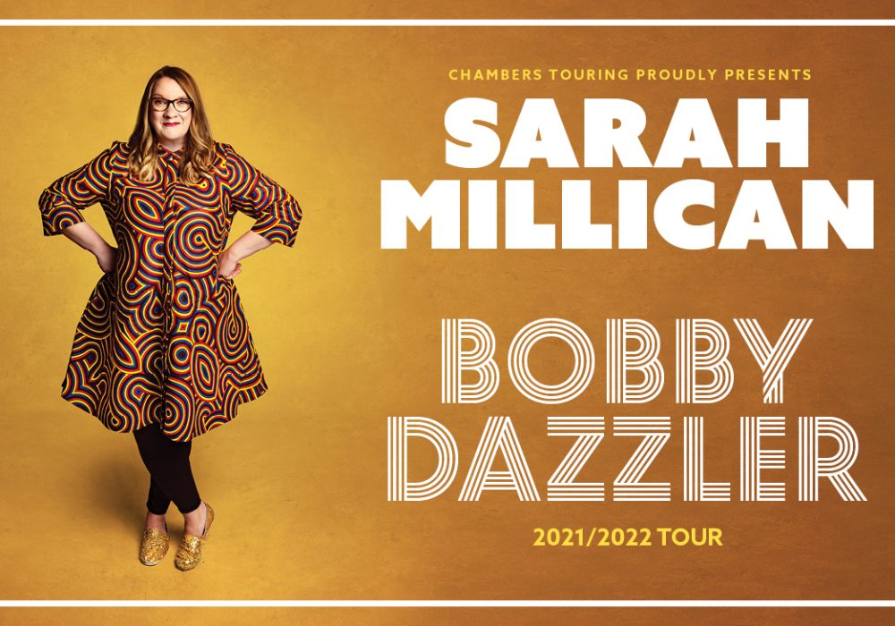 Sarah millican stood in front of a yellow background