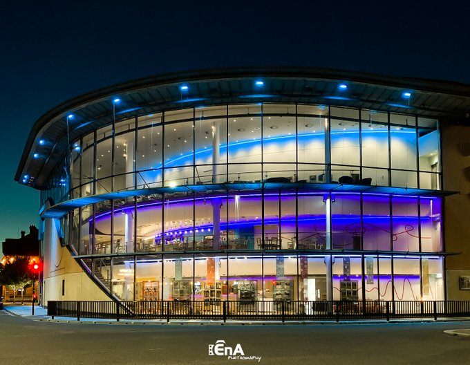 Exterior image of ARC lit up at night-time