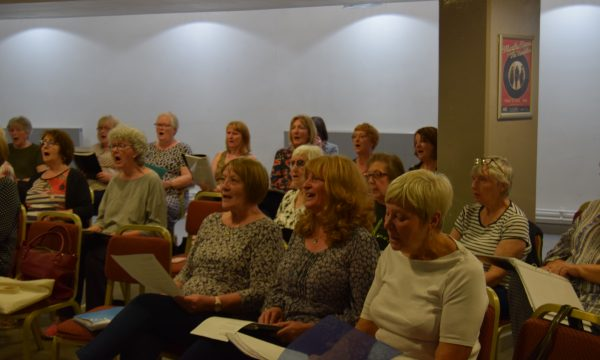 A group of people singing