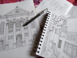 Image of sketchpads and pen