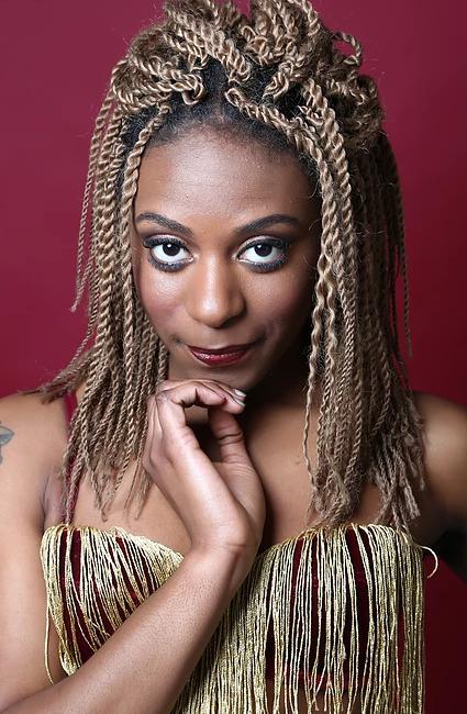 Headshot of artist Symoné
