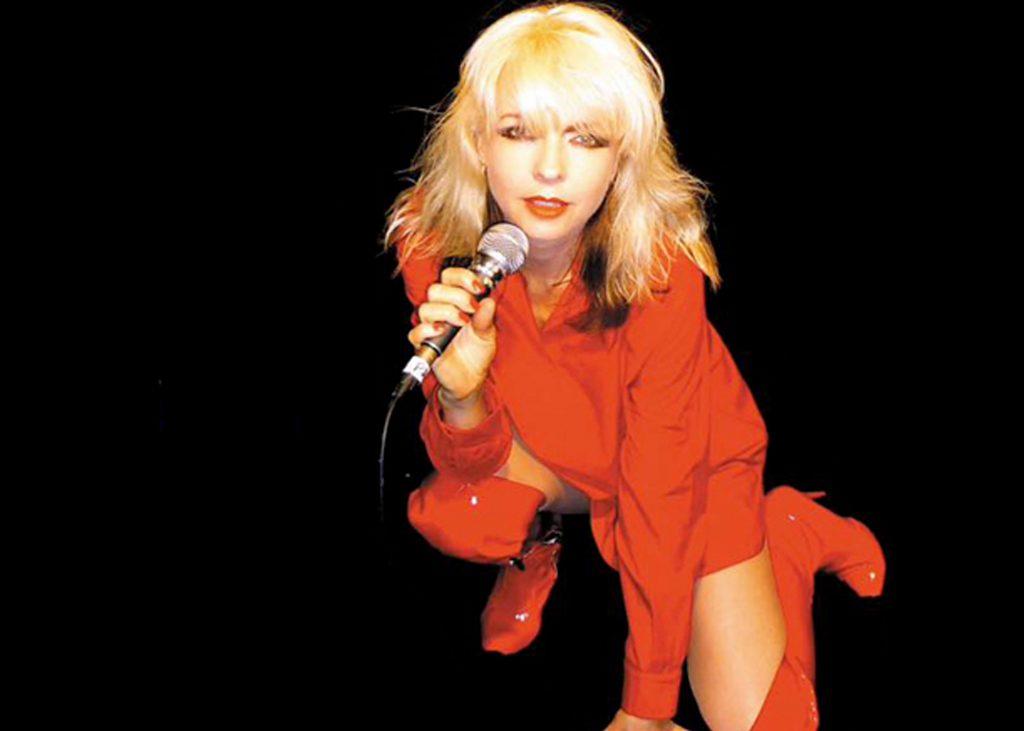 Debbie Harris from Bootleg Blondie wearing red outfit