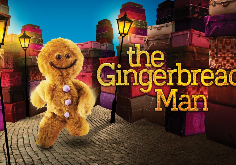 """A fluffy, cartoon gingerbread man runs down a cobbled, lamplit street. Text on the right saying """"The Gingerbread Man""""."""