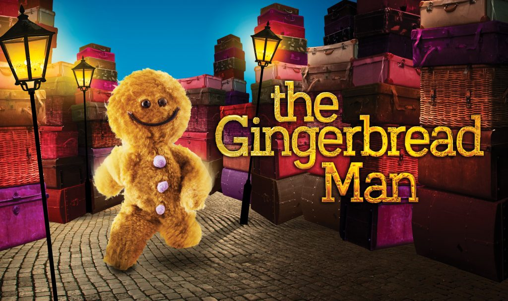 "A fluffy, cartoon gingerbread man runs down a cobbled, lamplit street. Text on the right saying ""The Gingerbread Man""."