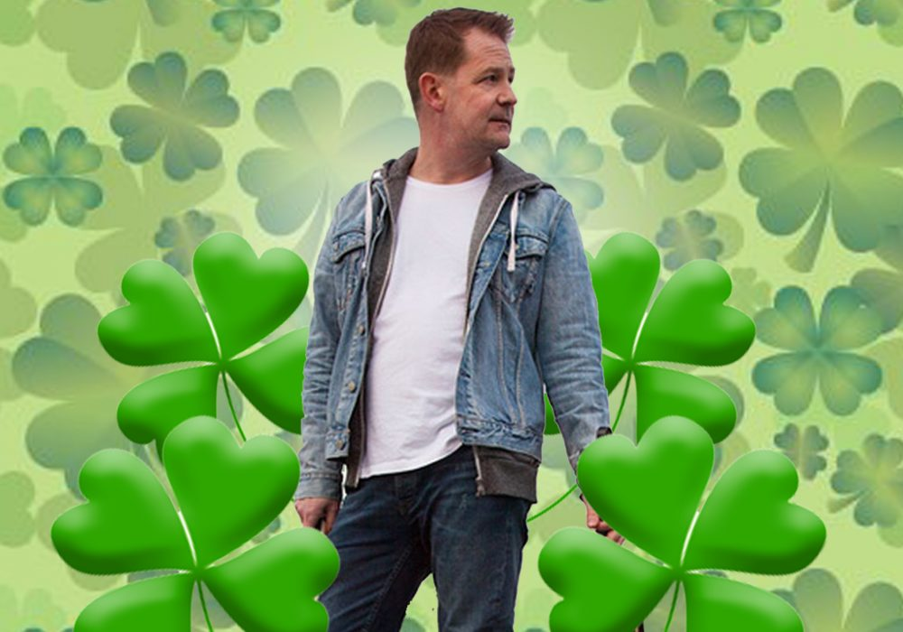 Mike Mcgrother standing in among shamrocks