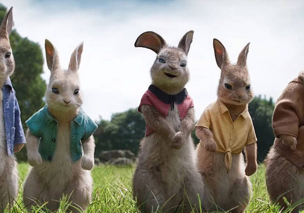 peter rabbit and his rabbit friends stood together
