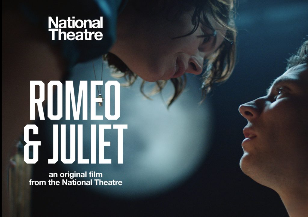A young man and a young woman stare into one another's eyes. Romeo & Juliet